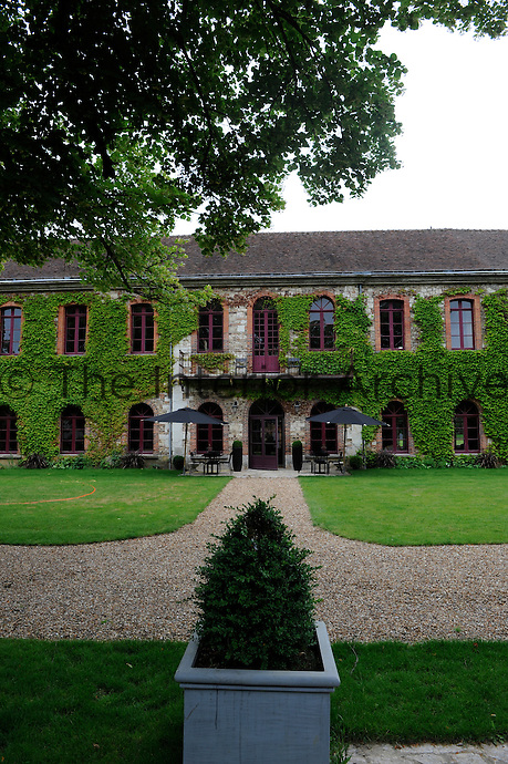 The facade of the converted barn of a chateau in Normandy is constructed from the traditional flint and brick