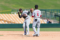 Scottsdale Scorpions infielders Alfredo Rodriguez (3) and Shed Long (6), both of the Cincinnati Reds organization, during an Arizona Fall League game against the Glendale Desert Dogs at Camelback Ranch on October 16, 2018 in Glendale, Arizona. Scottsdale defeated Glendale 6-1. (Zachary Lucy/Four Seam Images)