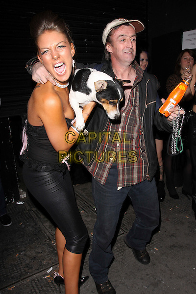 GIRL MODEL.Sunday Sport's 23rd Birthday Party, Studio Valbonne, London, England. .October 1st, 2009 .full length mouth open dog animal black leather .CAP/AH.©Adam Houghton/Capital Pictures.