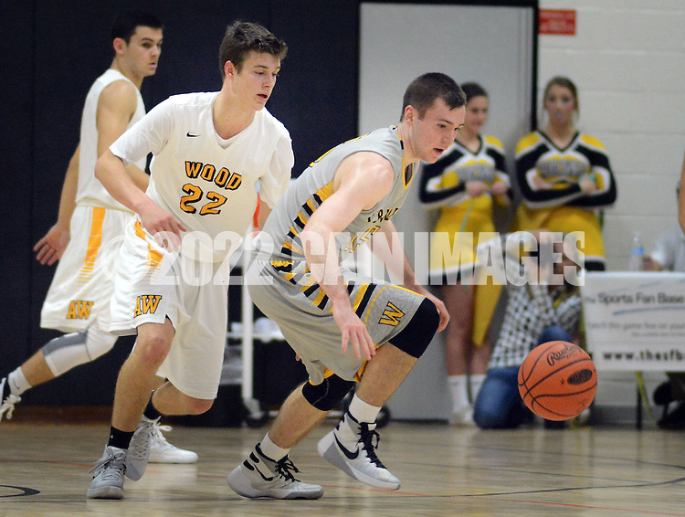 Archbishop Wood's Matt Cerutti (22) and Central Bucks West's Cal Reichwein (15) in the first quarter Saturday December 12, 2015 at Archbishop Wood in Warminster, Pennsylvania. (Photo by William Thomas Cain)
