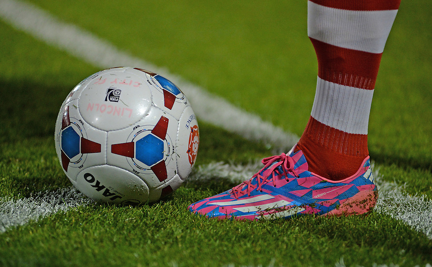 A close up of the boots worn by Lincoln City's Sean Newton<br /> <br /> Photo by Chris Vaughan/CameraSport<br /> <br /> Football - English Football Vanarama Conference Premier League - Lincoln City v Grimsby Town - Tuesdayb9th September 2014 - Sincil Bank - Lincoln<br /> <br /> &copy; CameraSport - 43 Linden Ave. Countesthorpe. Leicester. England. LE8 5PG - Tel: +44 (0) 116 277 4147 - admin@camerasport.com - www.camerasport.com