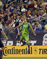 New England Revolution midfielder Seth Sinovic (27) and Seattle Sounders FC forward Roger Levesque (24) battle for head ball. The New England Revolution defeated the Seattle Sounders FC, 3-1, at Gillette Stadium on September 4, 2010.