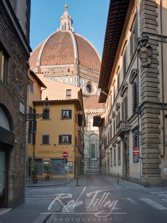 Europe, Italy, Tuscany, Florence, Street in Historic District with Cathedral (Duomo) in the Background.