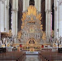 High altar of the choir in sculpted and gilded wood, 1755, and glory with sculpted clouds and angels, 1785, with the apsidal chapels behind, at the Basilique Cathedrale Notre-Dame d'Amiens or Cathedral Basilica of Our Lady of Amiens, built 1220-70 in Gothic style, Amiens, Picardy, France. Amiens Cathedral was listed as a UNESCO World Heritage Site in 1981. Picture by Manuel Cohen