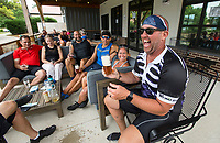 Matt Guthrie of Rogers enjoys a NWA Pint Day Hazy Pale Ale Saturday, June 20, 2020, after a group road bicycle ride ending at Natural State Beer Company in Rogers. The Hazy Pale Ale was brewed by Fossil Cove Brewing Company in Fayetteville for the second annual NWA Pint Day Saturday. Many breweries in Northwest Arkansas took part in the event to celebrate local brewers and breweries. A portion of Pint Day sales will help members of the craft brewing community affected by covid-19. Go to nwaonline.com/200621Daily/ to see more photos.<br /> (NWA Democrat-Gazette/Ben Goff)