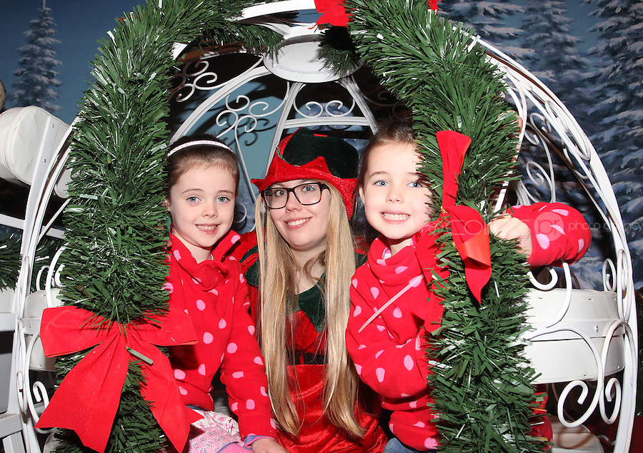 ****NO FEE PIC ******.19/11/2011.Santa's halper Evelina Lindell with Sarah Carey (5)& Emma Carey (6) both from Dundalk.at the opening of Santa's Playland in The Ambassador Theatre,Dublin.One of this Christmas' biggest events is coming!  Santa's Playland takes up residence at The Ambassador Theatre in preparation for this year's festive season.  The spectacular event opens on Saturday 19 November and runs until Friday 23 December. Santa's Playland will see children transported to a magical Christmas paradise.On entering Santa's Playland children will be treated to a special Christmas play time.  The Play Area is full of Christmas treats with bouncy castles, slides and Christmas displays..Photo: Gareth Chaney Collins