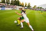 Two female soccer players on the field at University of Portland.
