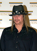 "Bob Ritchie (Kid Rock) arrives at the Harry S. Truman Building (Department of State) in Washington, D.C. on December 4, 2004 for a dinner hosted by United States Secretary of State Colin Powell.  At the dinner six performing arts legends will receive the Kennedy Center Honors of 2004.  This is the 27th year that the honors have been bestowed on ""extraordinary individuals whose unique and abundant artistry has contributed significantly to the cultural life of our nation and the world"" said John F. Kennedy Center for the Performing Arts Chairman Stephen A. Schwarzman.  The award recipients are: actor, director, producer, and writer Warren Beatty; husband-and-wife actors, writers and producers Ossie Davis and Ruby Dee; singer and composer Elton John; soprano Joan Sutherland; and composer and conductor John Williams..Credit: Ron Sachs / CNP"