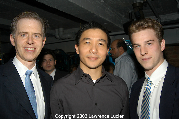 NEW YORK - SEPTEMBER 17: Designer Paul Chan (c) and  Sullivan and Cromwell executives Donald Toumey (L) and Matthew Gunnison appear September 17, 2003, for the Chanpaul fashion show after party at Ian Schrager's Morgans Bar in New York City.