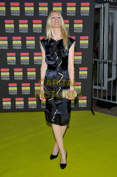 CLAUDIA SCHIFFER.Arrivals at the Graduate Fashion Week Awards 2008, Earls Court, London England. .10th June 2008.full length black dress belt silver clutch bag purse ruffled ruffles.CAP/PL.©Phil Loftus/Capital Pictures