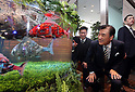 "March 15, 2017, Urayasu, Japan - Japan's travel agency H.I.S. president Hideo Sawada admires Korean made fish robots Airo swimming in the fish tank at the opening of his ""Henn na Hotel"" (Strange hotel) near Tokyo Disney Resort in Urayasu, suburban Tokyo on Wednesday, March 15, 2017. Japan's travel agency H.I.S runs the Henn na Hotel which has only seven human employees while nine types 140 robot staffs work at the 100-room six-storey hotel.    (Photo by Yoshio Tsunoda/AFLO) LwX -ytd-"
