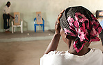A patient has her sight tested at Buduburam Refugee Camp Community outreach center. The camp, a 1.5 hour drive from Accra, is for those displaced by the civil war in Liberia; the outreach center is a service of the Crystal Eye Clinic.
