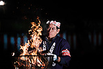 Chichibu Festival Yataijyoji festival-goer takes care of fire in the street of Chichibu City, Saitama Prefecture on December 3, 2018. People carry a mikoshi and floats with fireworks during the Chichibu Night Festival. The 300-year-history festival took place at the Chichibu Shrine and nearly 200,000 people enjoyed the festival. Chichibu festival's Yataigyoji and Kagura dance were officially added on the UNESCO's list of Intangible Cultural Heritage as one of set of 33 festivals in Japan that involve in yama, hoko, and yatai floats in 2016. December 3, 2018 (Photo by Nicolas Datiche/AFLO) (JAPAN)