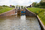 Maintenance boat at Caen Hill flight of locks on the Kennet and Avon canal Devizes, Wiltshire, England