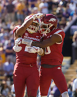NWA Democrat-Gazette/BEN GOFF @NWABENGOFF<br /> Devwah Whaley (left), Arkansas running back, and Jordan Jones, Arkansas wide receiver, celebrate after Whaley scored against LSU in the second quarter Saturday, Nov. 11, 2017 at Tiger Stadium in Baton Rouge, La.