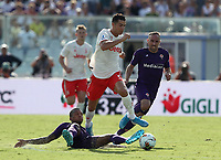 Calcio, Serie A: Fiorentina - Juventus, stadio Artemio Franchi Firenze 14 settembre 2019<br /> Juventus' Cristiano Ronaldo (c) in action with Fiorentina's Franck Ribery (r) and Dalbert (l) during the Italian Serie A football match between Fiorentina and Juventus at Florence's Artemio Franchi stadium, September 14, 2019. <br /> UPDATE IMAGES PRESS/Isabella Bontto