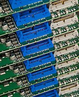 Power supply circuit boards sit ready for solder at AVCom Inc. in Westerville, Ohio, Thursday, Nov. 30, 2006.<br />