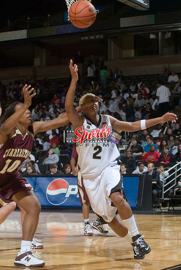 Alex Tchangoue (2) of the Wake Forest Demon Deacons is hit in the face by Nikki Williams (10) of the College of Charleston Cougars during second half action at the LJVM Coliseum Wednesday, December 19, 2007 in Winston-Salem, NC.