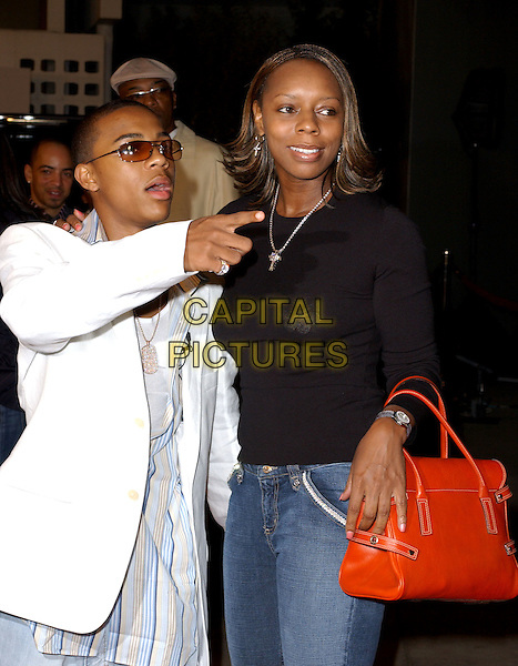 BOW WOW & MOTHER .World Premiere of Johnson Family Vacation held at The Cinerama Dome in Hollywood, California .31 March 2004.*UK Sales Only*.half length, half-length, red birkin style bag, handbag, mum, pointing.www.capitalpictures.com.sales@capitalpictures.com.©Capital Pictures.