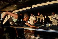 TANZANIA Geita, artisanal gold mining in Mgusu, where about 4000 people live and work, young miner play billiards after work  / TANSANIA Geita, kleine Goldminen in Mgusu, hier arbeiten und leben ca. 4000 Menschen, junger Bergleute spielen Billard nach der Arbeit