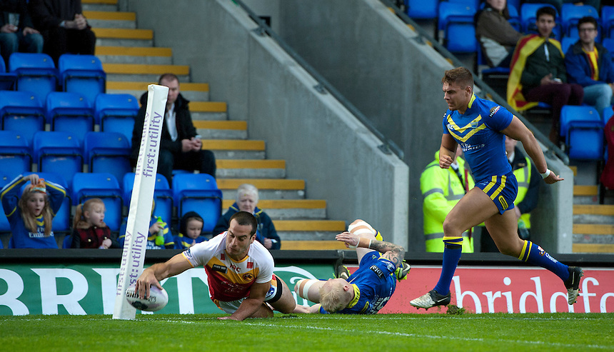 Warrington Wolves' Rhys Evans manages to push Catalan Dragons' Michael Oldfield out of bounds preventing a try as confirmed by the TV replay<br /> <br /> Photographer Stephen White/CameraSport<br /> <br /> Rugby League - First Utility Super League - Round 12 - Warrington Wolves v Catalan Dragons - Friday 9th May 2014 - The Halliwell Jones Stadium - Warrington<br /> <br /> &copy; CameraSport - 43 Linden Ave. Countesthorpe. Leicester. England. LE8 5PG - Tel: +44 (0) 116 277 4147 - admin@camerasport.com - www.camerasport.com