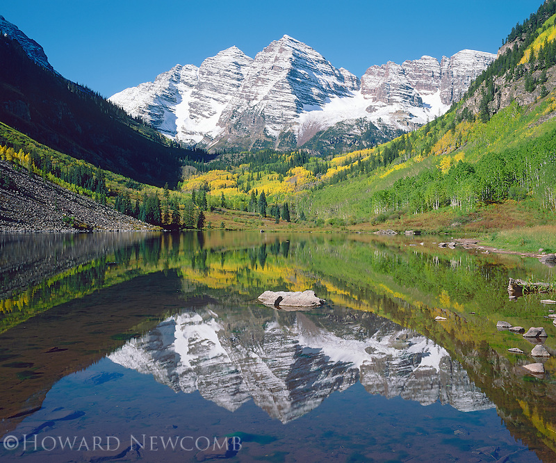 A perfect autumn mirror reflection of the Maroon Bells in Maroon Lake, near Aspen, Colorado.