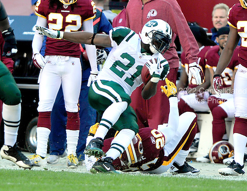 New York Jets running back LaDainian Tomlinson (21) is tackled by Washington Redskins safety Oshiomogho Atogwe (20) during the game at FedEx Field in Landover, Maryland on Sunday, December 4, 2011.  Tomlinson was injured on the play.  The Jets won the game 34 - 19..Credit: Ron Sachs / CNP.(RESTRICTION: NO New York or New Jersey Newspapers or newspapers within a 75 mile radius of New York City)
