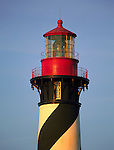 The first rays of the sun strike the saint Augustine lighthouse give it a golden cast.
