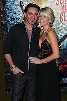 """HOLLYWOOD, LOS ANGELES, CA, USA - MARCH 04: Patrick Tatopoulos, McKenzie Westmore at the Los Angeles Premiere Of Warner Bros. Pictures And Legendary Pictures' """"300: Rise Of An Empire"""" held at TCL Chinese Theatre on March 4, 2014 in Hollywood, Los Angeles, California, United States. (Photo by Xavier Collin/Celebrity Monitor)"""