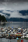 Deep Cove jetty with clouds above the mountains over Mount Seymour provincial park. Deep Cove, Burrard Inlet, Vancouver, British Columbia, Canada.