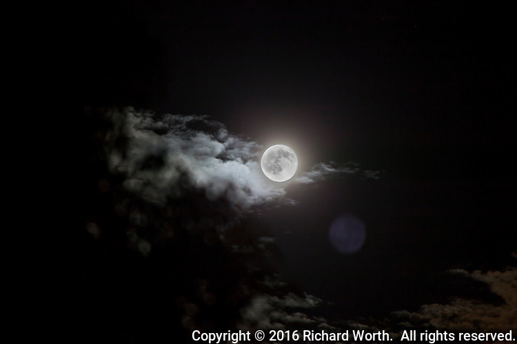 The June 2016 full moon, the Strawberry, Rose or Honey Full Moon coincided with the summer solstice.  Here, two images have been combined - the full moon with clouds drifting by.