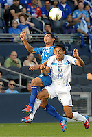 sidro Gutierrez (9) El Salvador wins the header against Andy Najar (14) Honduras... Honduras defeated El Salvador 3-2 after extra time to go through to the final at LIVESTRONG Sporting Park, Kansas City, Kansas.