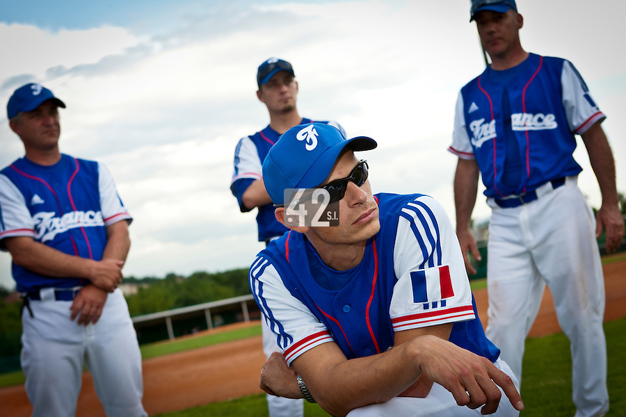 22 June 2011: Team France manager Fabien Proust talks to his players after AIST Alumni 5-3 win over France, at the 2011 Prague Baseball Week, in Prague, Czech Republic.