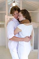 Young couple embracing in doorway