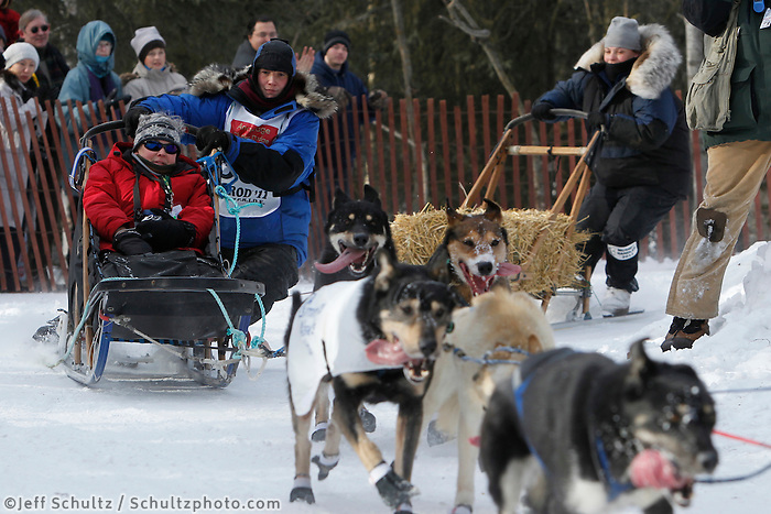 Jessica Hendricks rounds a corner on the bike trail in mid-town Anchorage during the ceremonial start of the 2011 Iditarod
