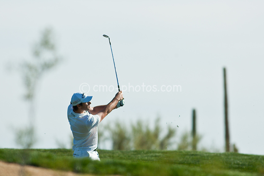 Feb 27, 2009; Marana, AZ, USA; Oliver Wilson (ENG) hits his approach shot on the 1st fairway during the first playoff hole of his match against Justin Leonard (USA), not pictured, in the third round of the World Golf Championships-Accenture Match Play Championship at the Ritz-Carlton Golf Club, Dove Mountain.