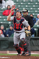 Lehigh Valley IronPigs catcher Erik Kratz #19 reacts to a pop up in front of umpire Craig Barron during a game against the Rochester Red Wings at Frontier Field on April 22, 2012 in Rochester, New York.  Rochester defeated Lehigh Valley 3-2.  (Mike Janes/Four Seam Images)