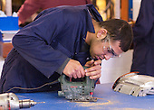 Cutting out a board to display headlights, Motor Mechanics, Further Education College.