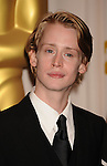 HOLLYWOOD, CA. - March 07: Presenter Macaulay Culkin poses in the press room at the 82nd Annual Academy Awards held at the Kodak Theatre on March 7, 2010 in Hollywood, California.