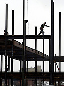 High above; A union steel worker navigates a beam during construction of a five-story commercial building in Birmingham last week.  Although building has halted in most area communities, Birmingham still has it's sites set on future expansion.