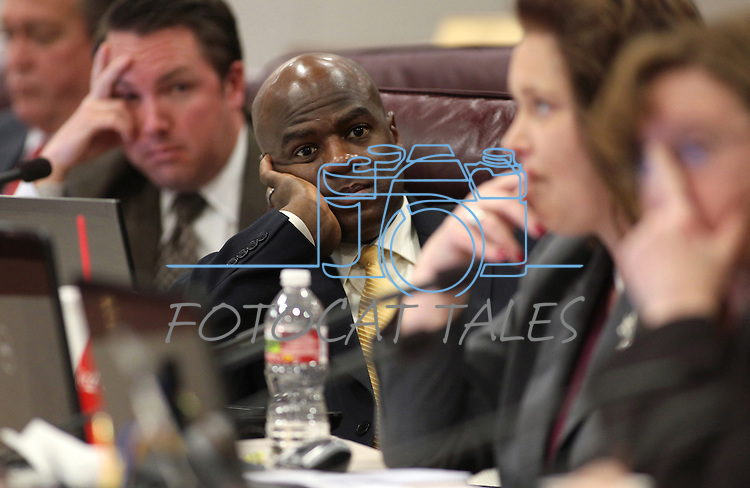 Nevada Assemblyman Kelvin Atkinson, D-North Las Vegas, listens to debate over cuts to state employee pay during a joint budget hearing Tuesday morning, May 10, 2011, at the Legislature in Carson City, Nev. Lawmakers approved, by party lines, a compromise measure combining a 2.5 percent pay cut with a six-day furlough. .Photo by Cathleen Allison