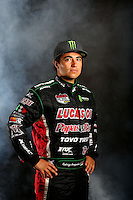 Mar. 22, 2014; Chandler, AZ, USA; LOORRS pro 2 driver Rodrigo Ampudia poses for a portrait prior to round one at Wild Horse Motorsports Park. Mandatory Credit: Mark J. Rebilas-USA TODAY Sports