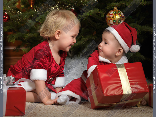 Kids with Gifts under a Christmas Tree stock photography ...