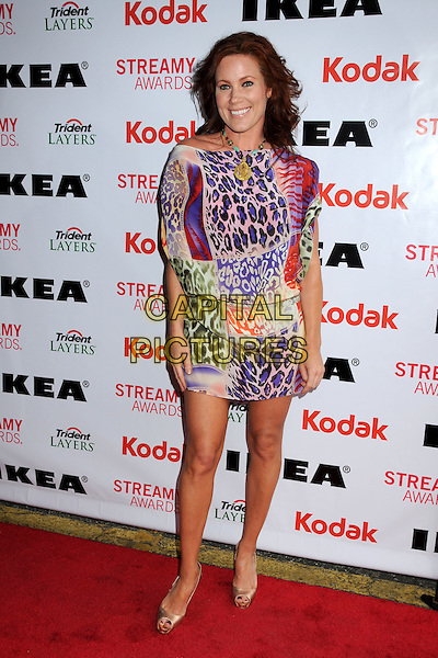 ELISA DONOVAN .The 2nd Annual Streamy Awards held at the Orpheum Theatre, Los Angeles, California, USA, 11th April 2010 .full length multi-coloured purple red leopard print dress animal mini off the shoulder .CAP/ADM/BP.©Byron Purvis/AdMedia/Capital Pictures.