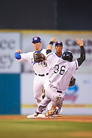 Chattanooga Lookouts second baseman Levi Michael (9) turns a double play as Austin Nola (36) slides in with Jorge Polanco backing up the play during a game against the Jacksonville Suns on April 30, 2015 at AT&T Field in Chattanooga, Tennessee.  Jacksonville defeated Chattanooga 6-4.  (Mike Janes/Four Seam Images)