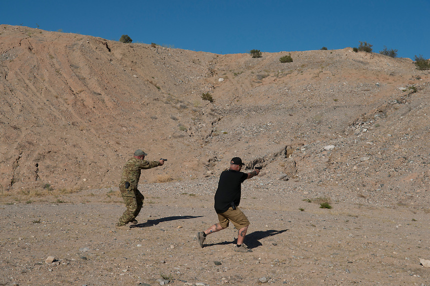 "Militia members train with handguns  at camp ""Liberty"" near the Cliven Bundy ranch in Bunkerville, Nevada, USA."