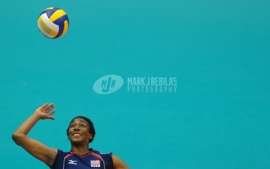 Jul 15, 2007; Rio de Janeiro, Brazil; Foluke Akinradewo (USA) spikes the ball against Puerto Rico during the preliminary round of womens volleyball at the Ginasio do Maracanazinho in the Pan American Games at the Multipurpose Arena in Rio de Janeiro. United States defeated Puerto Rico 3-1. Mandatory Credit: Mark J. Rebilas-US PRESSWIRE Copyright © 2007 Mark J. Rebilas