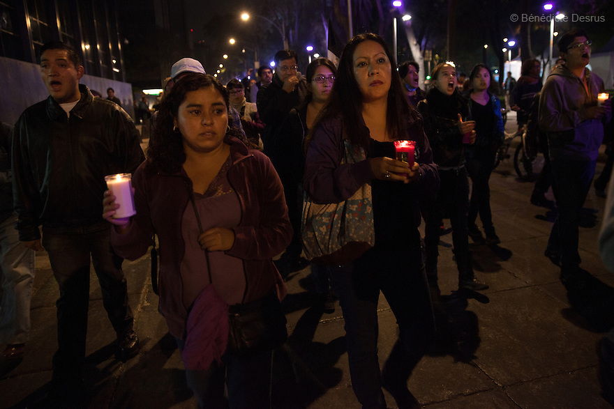 Demonstrators hold candles and march  towards Los Pinos presidential residence during a New Year's Eve protest for the disappearance of the 43 Ayotzinapa's students in Mexico City, Mexico on December 31, 2014. The relatives of the 43 missing students do not believe the official line that the young men are all dead. The 43 students went missing on Sept. 26 after confrontations in which police gunfire killed six people and wounded at least 25 in Iguala, in Guerrero state. Alexander Mora Venancio, one of the 43 Ayotzinapa's missing students, has been identified and confirmed dead by authorities. Many are demanding justice and that the search for the 42 missing students continue until there is concrete evidence to the contrary. Mexico – officially - lists more than 20 thousand people as having gone missing since the start of the country's drug war in 2006, and the search for the missing students has turned up other, unrelated mass graves. (Photo by Bénédicte Desrus)