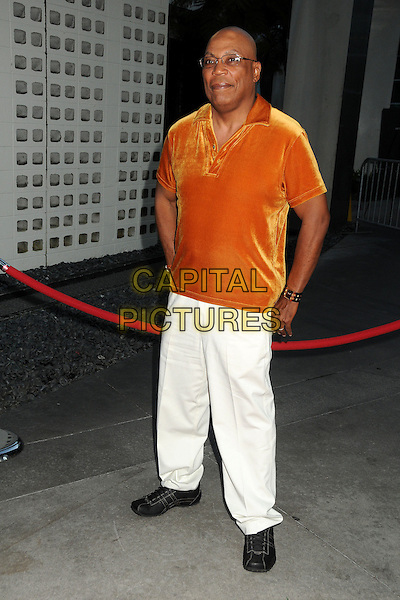 """Paris Barclay.""""Sons Of Anarchy"""" Season 4 Premiere Screening held at the Cinerama Dome, Hollywood, California, USA..August 30th, 2011.full length white trousers orange velvet top glasses .CAP/ADM/BP.©Byron Purvis/AdMedia/Capital Pictures."""