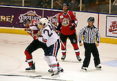 February 22nd 2008:  Matt Carkner (22) of the Binghamton Senators fights Anthony Stewart (24) of the Rochester Amerks as linesman Michael Baker and Shawn Weller (9) watch at Blue Cross Arena at the War Memorial in Rochester, NY.  The Senators defeated the Amerks 4-0.   Photo copyright Mike Janes Photography